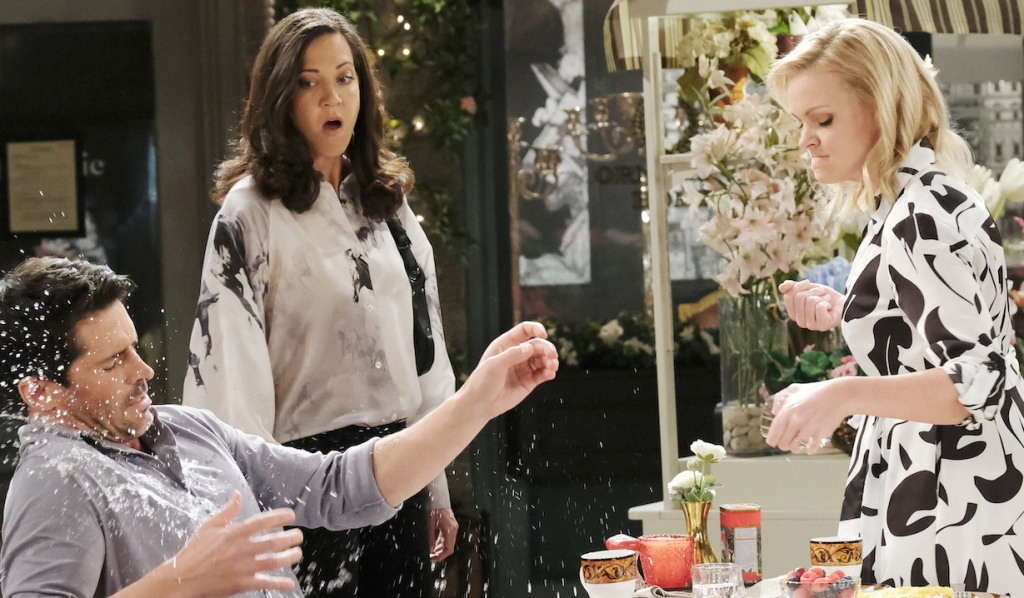 Jan watches as Belle throws drink on Shawn on Days of Our Lives