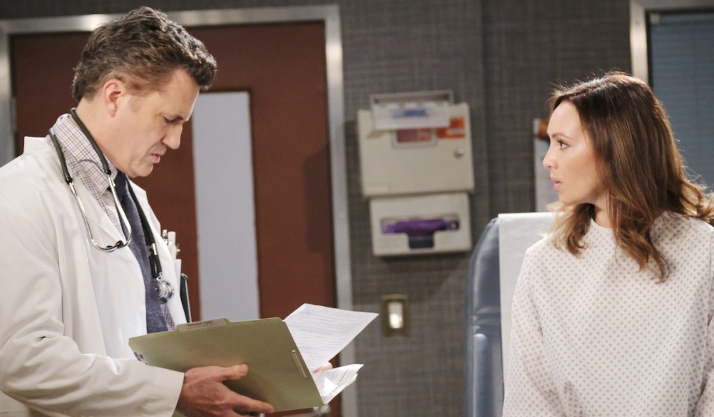 Dr. Snyder reads Gwen's chart at the hospital on Days of Our Lives