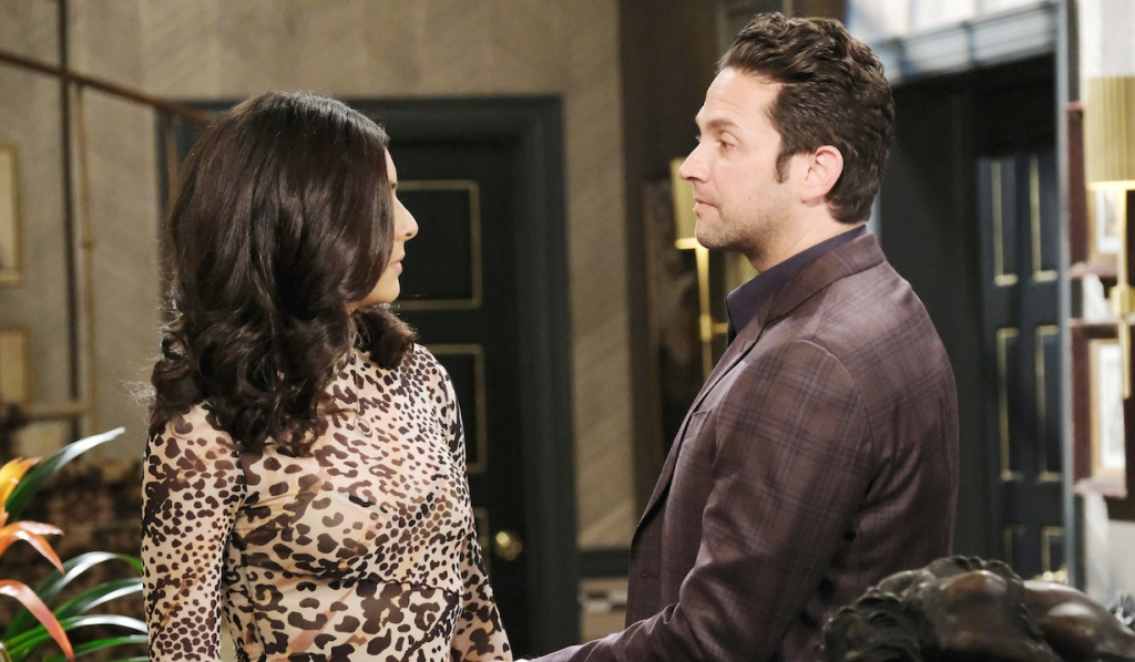 Jake grabs Gabi's arm to make a point on Days of Our Lives