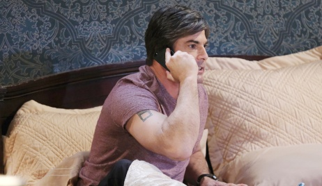 Lucas makes a phone call from bed on Days of Our Lives
