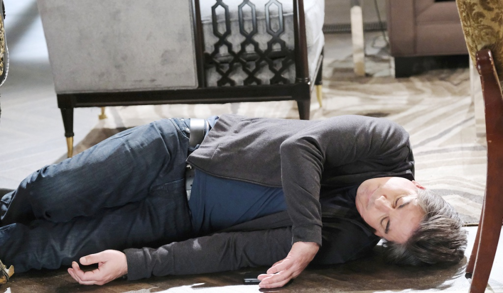 Lucas lies unconscious on the DiMera living room floor on Days of Our Lives