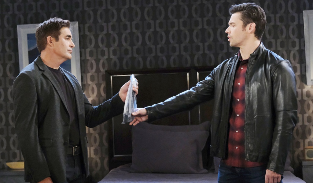 Rafe holds out an evidence bag to Xander on Days of Our Lives