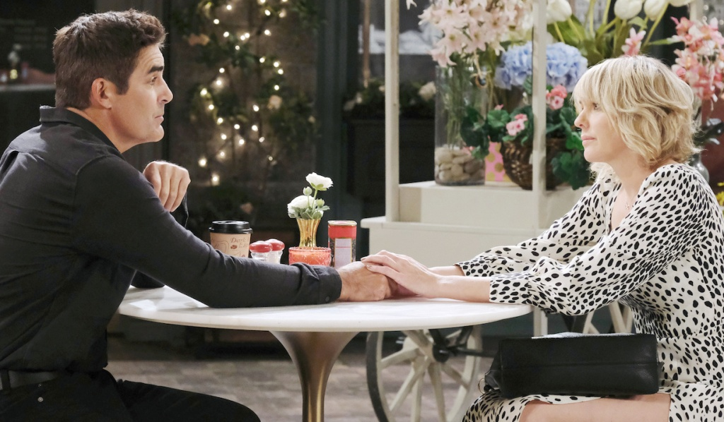 Rafe and Nicole touch hands in Horton Square on Days of Our Lives