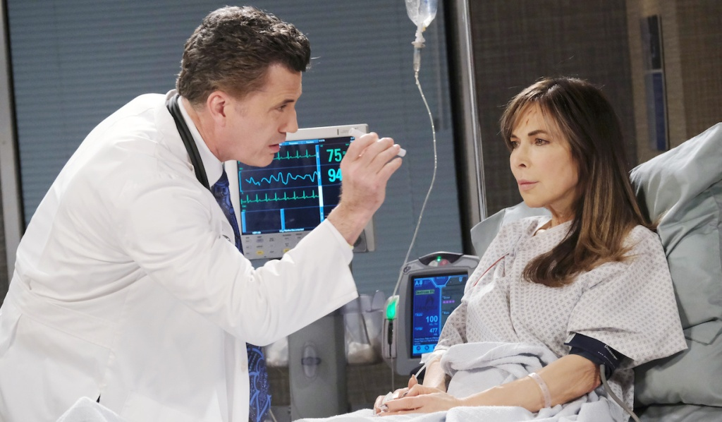 Dr. Snyder checks Kate's eyes on Days of Our Lives