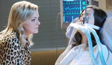 Belle leans in close to a comatose Jan on Days of Our Lives