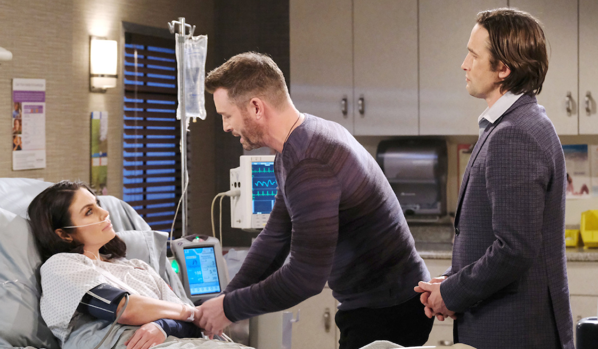 Philip watches Brady fawn over Chloe in the hospital on Days of Our Lives