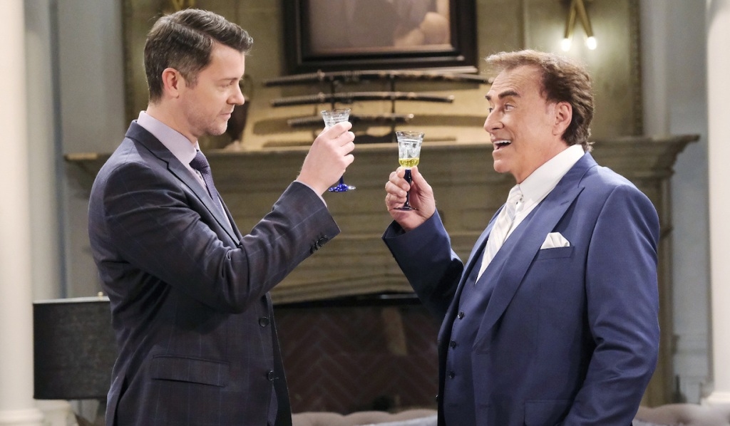 EJ and Tony toast in front of Stefano's portrait on Days of Our Lives