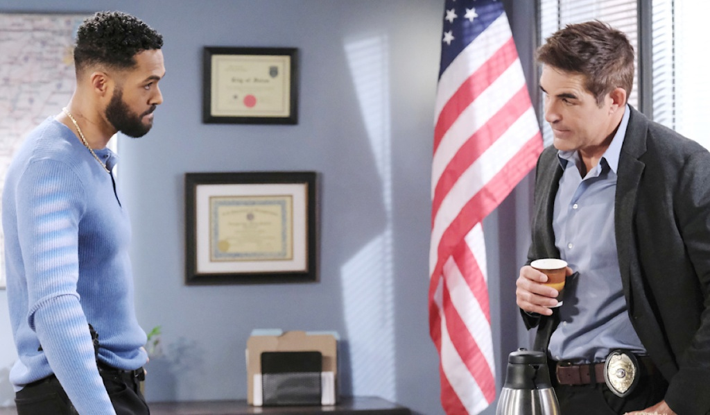 Eli and Rafe talk in the SPD office
