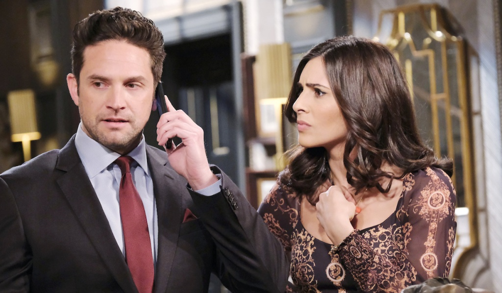 Gabi stresses as Jake talks on the phone on Days of Our Lives