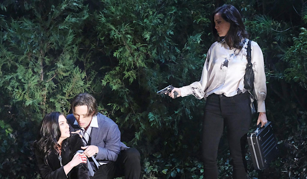 Jan holds a gun on Philip and Chloe near the airfield on Days of Our Lives