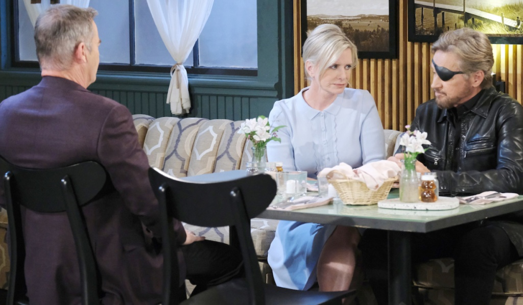 Justin sits across a table from Kayla and Steve at Julie's Place on Days of Our Lives
