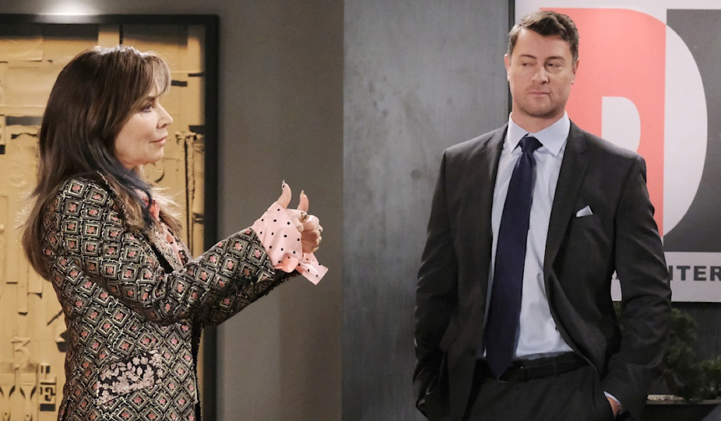 EJ smirks as Kate gives a thumbs up at DiMera Enterprises on Days of Our Lives