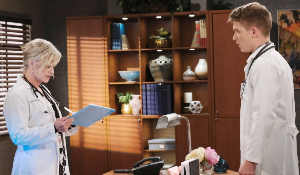 Kayla and Tripp talk in her office on Days of Our Lives