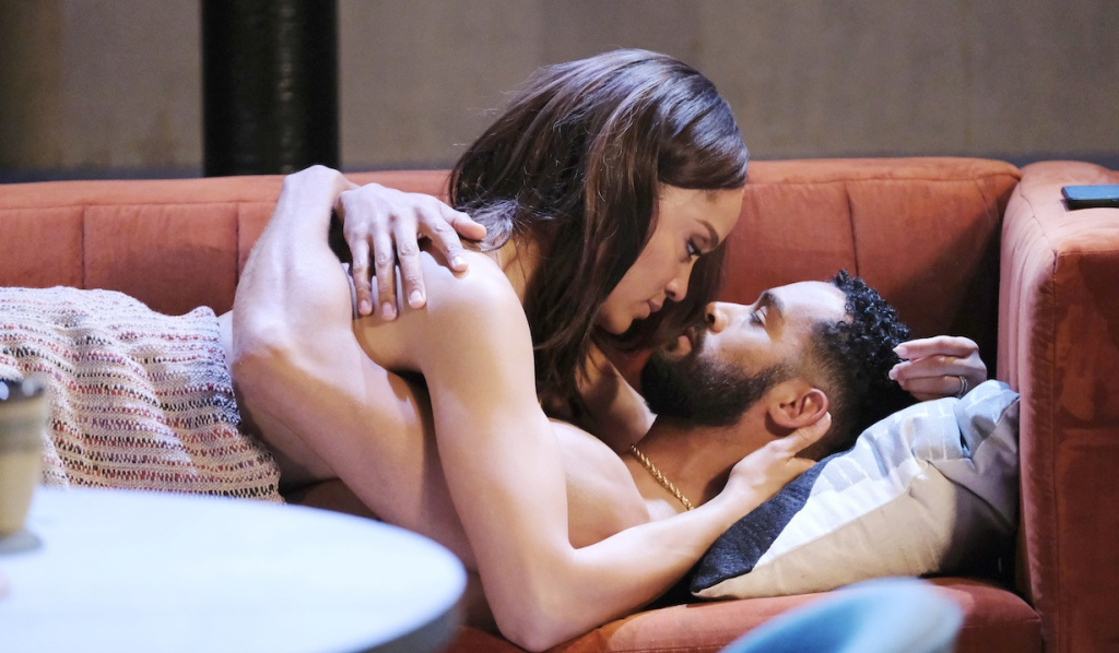 Lani and Eli lay naked in each other's arms under a blanket on the couch on Days of Our Lives