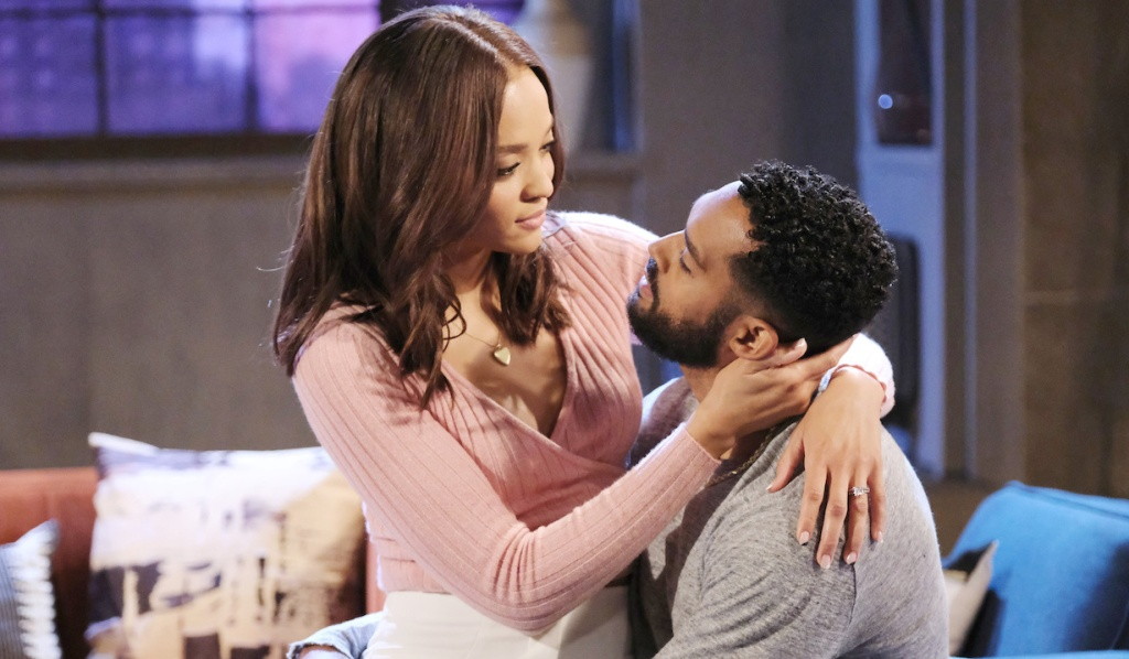 Lani sits on Eli's lap on Days of Our Lives