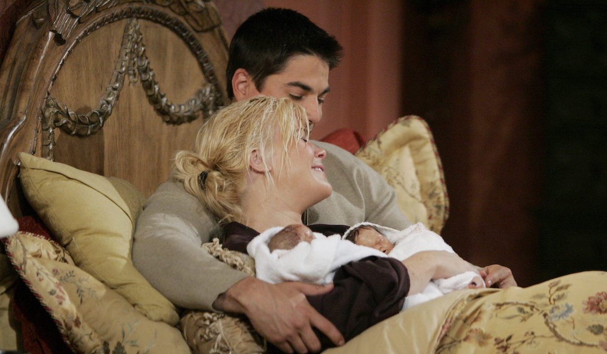 Lucas holds Sami who holds Johnny and Allie after giving birth on Days of Our Lives