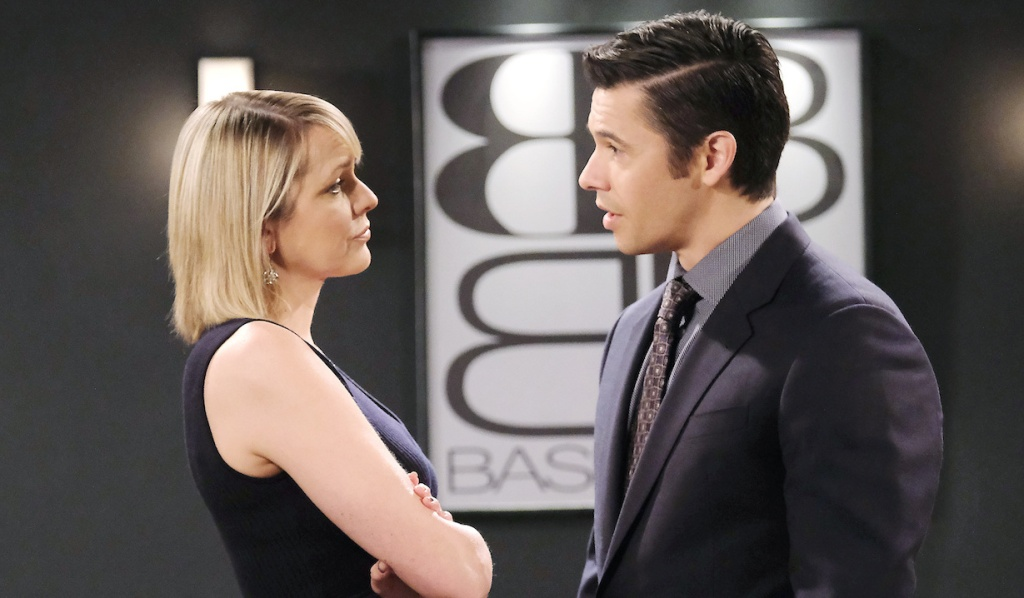 Nicole crosses her arms and gives Xander a defiant look on Days of Our Lives