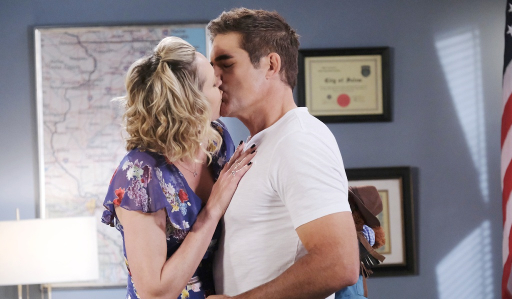 Nicole and Rafe kiss in Rafe's office on Days of Our Lives