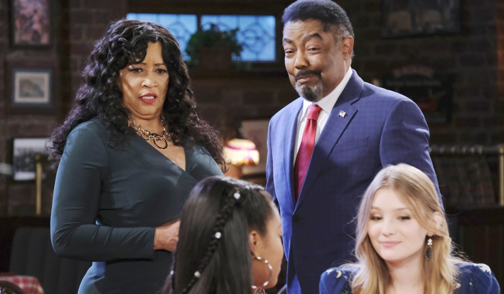 Paulina and Abe look at Chanel and Allie sitting at a Brady's Pub table on Days of Our Lives