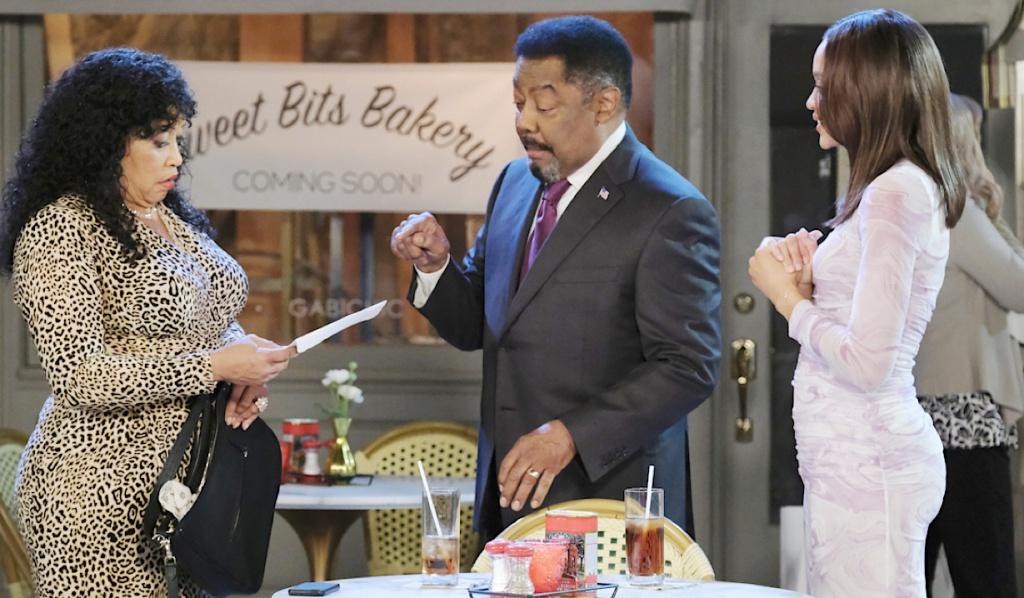 Paulina, Abe and Lani in front of the Sweet Bits sign in Horton Square on Days of Our Lives