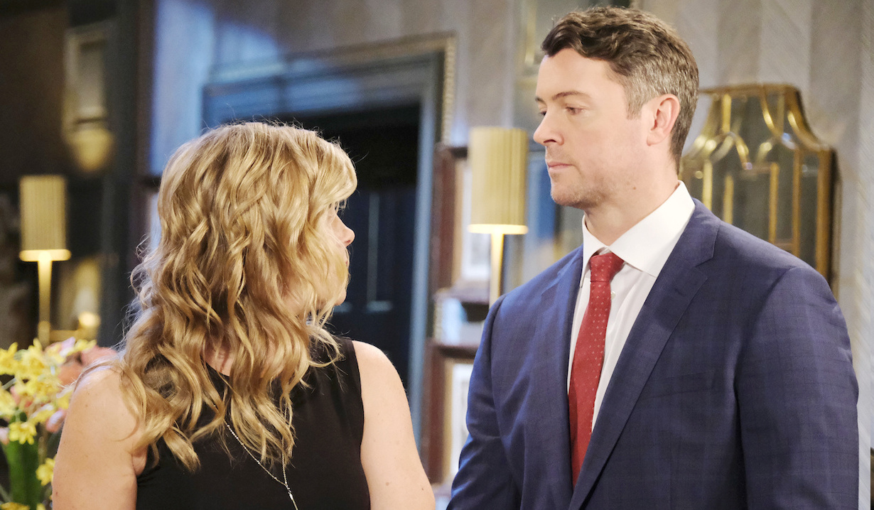 EJ looks sternly at Sami in the DiMera mansion on Days of Our Lives