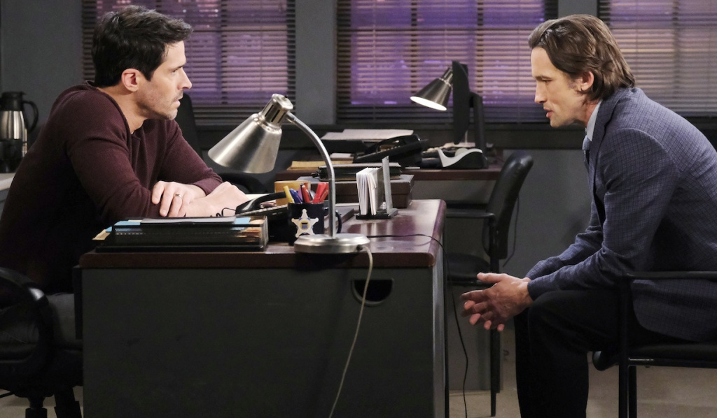 Shawn and Philip confer at the Salem PD on Days of Our Lives