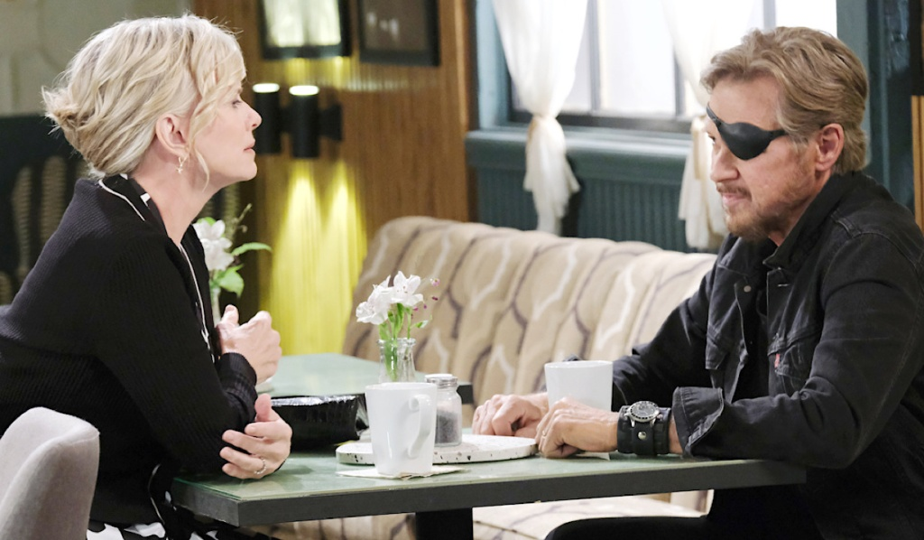 Steve and Kayla sit across from each other at Julie's Place on Days of Our Lives