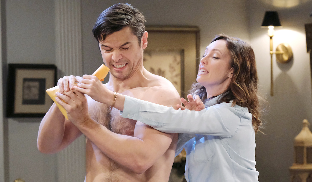 Xander and Gwen struggle over an envelope on Days of Our Lives