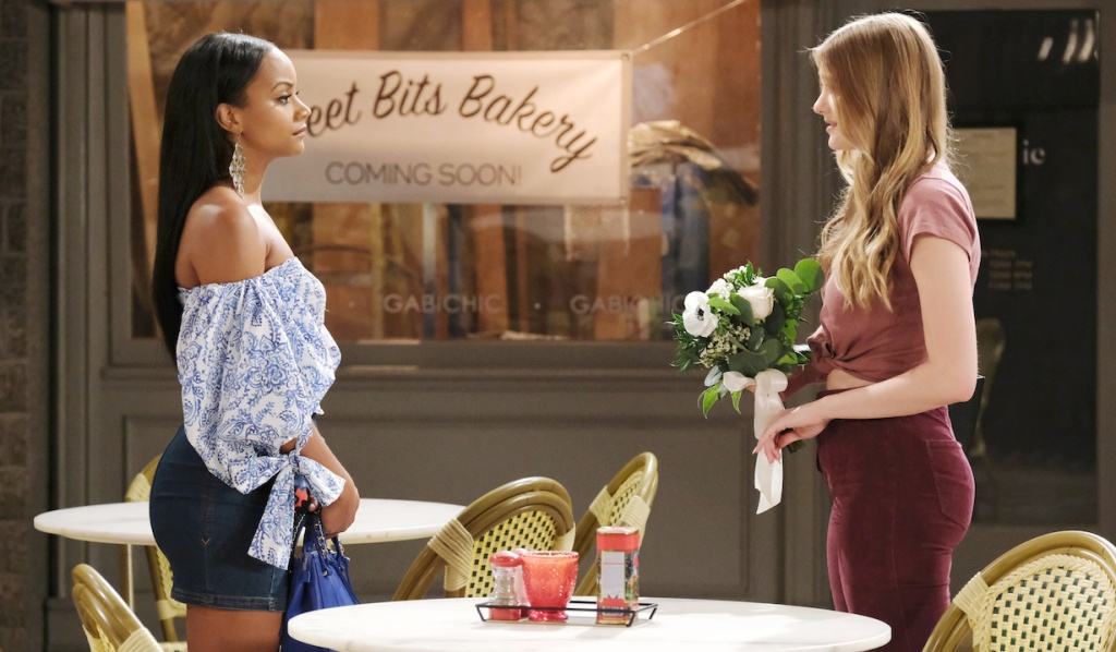 Chanel and Allie face each other in front of Sweet Bits on Days of Our Lives
