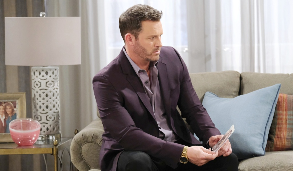Brady looks concerned with Chloe's photo on Days of Our Lives