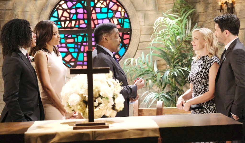 The Carvers and the Bradys gather in front of a stained glass window in church on Days of Our Lives