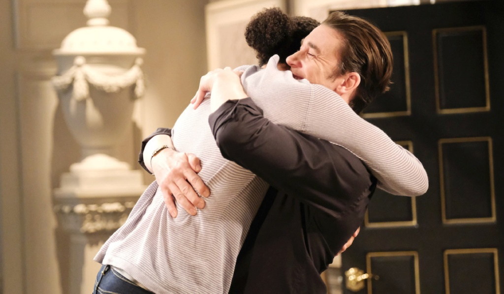 Chad picks Theo up in a hug on Days of Our Lives