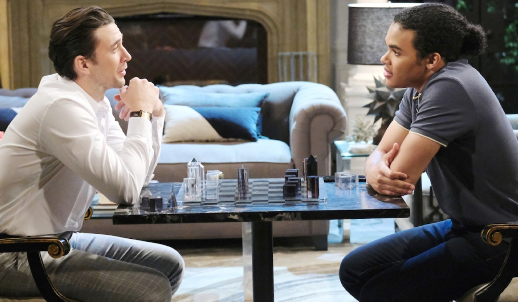 Chad and Theo talk over a chess board on Days of Our Lives