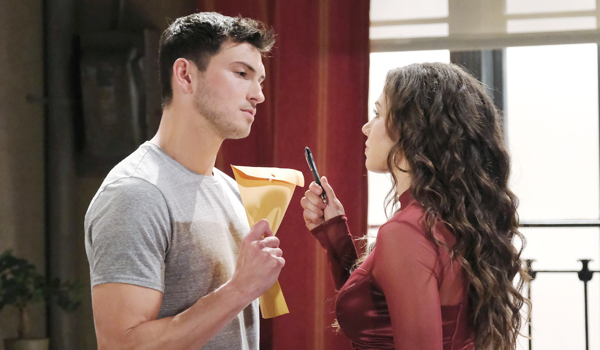 Ciara holds a pen for Ben to sign divorce papers on Days of Our Lives