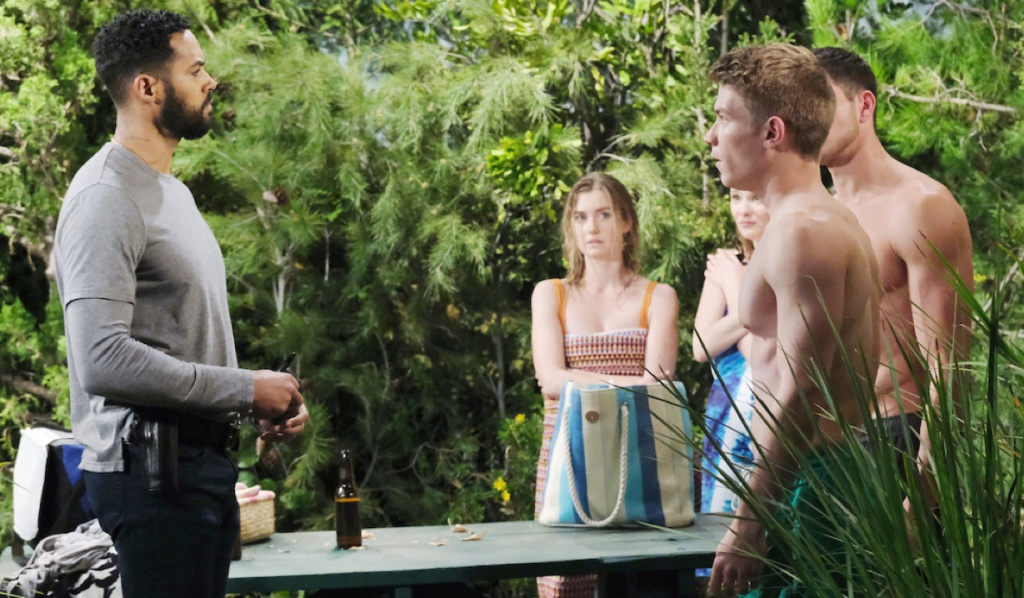 Eli questions Tripp, Ben, Claire, Allie at the beach on Days of Our Lives