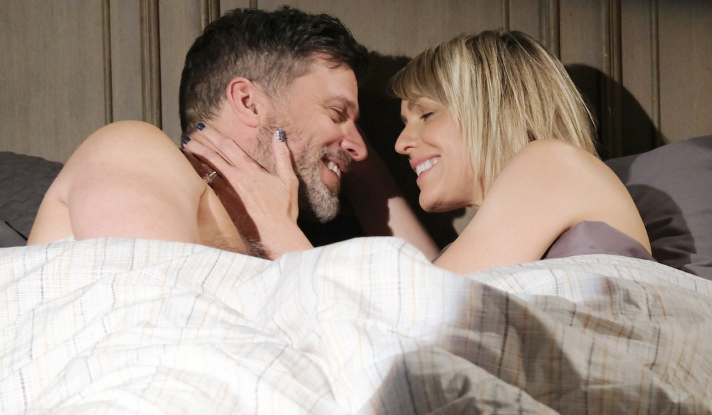 Eric and Nicole smile at each other in bed on Days of Our Lives