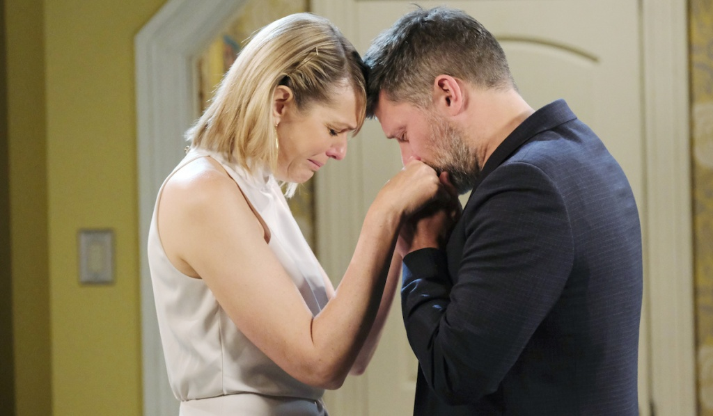 Nicole cries as Eric kisses her hands on Days of Our Lives