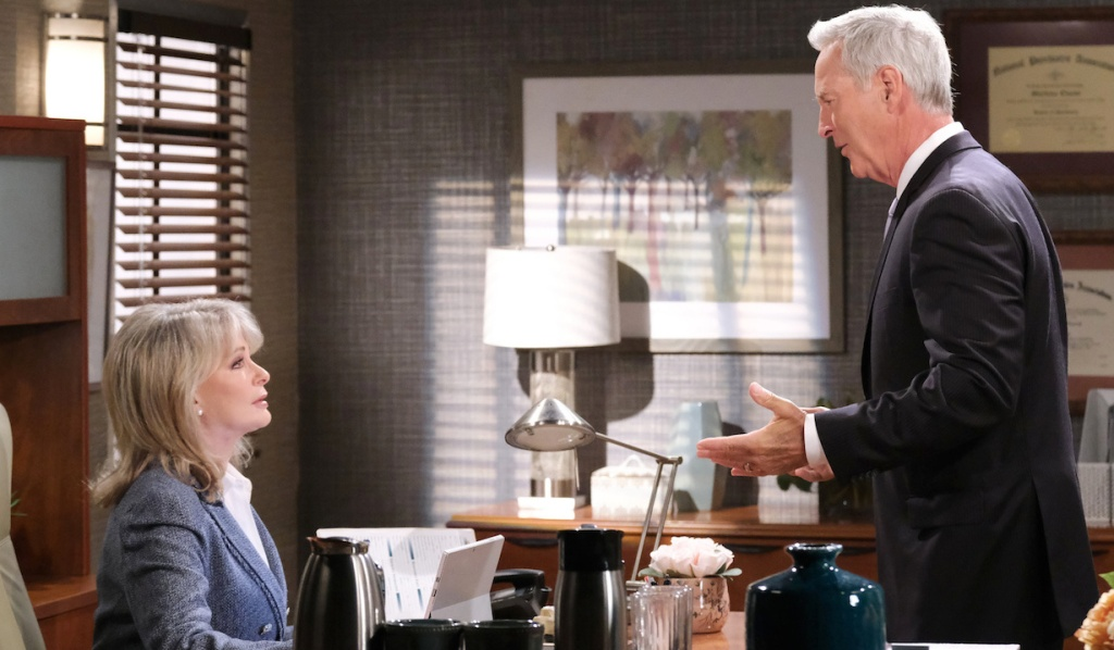 John and Marlena have a heated discussion in her office on Days of Our Lives