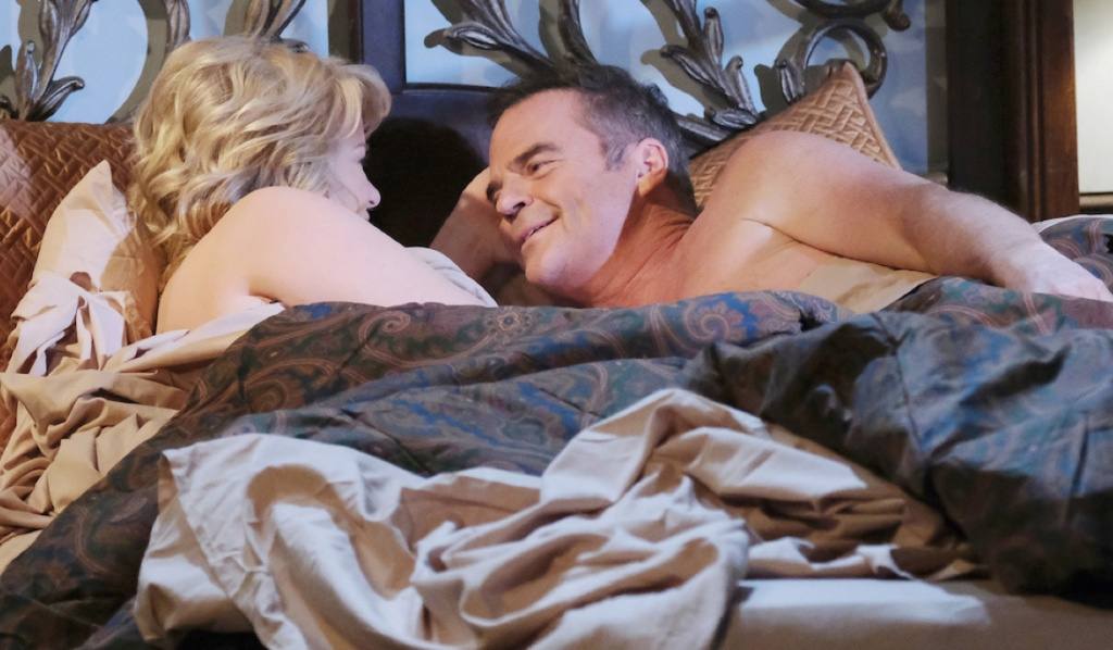 Justin smiles at Bonnie in bed on Days of Our Lives
