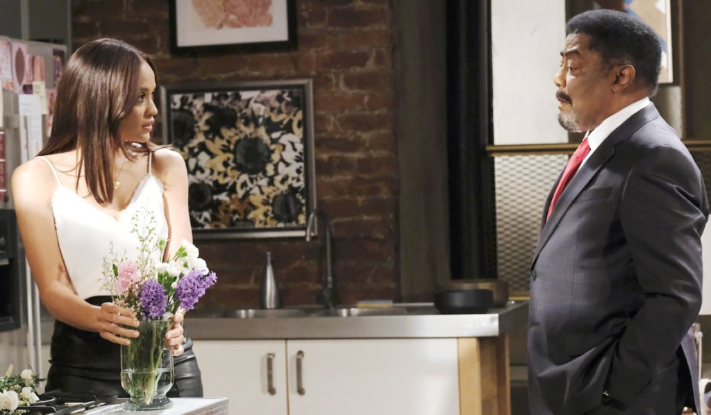 Lani and Abe talk in her kitchen on Days of Our Lives