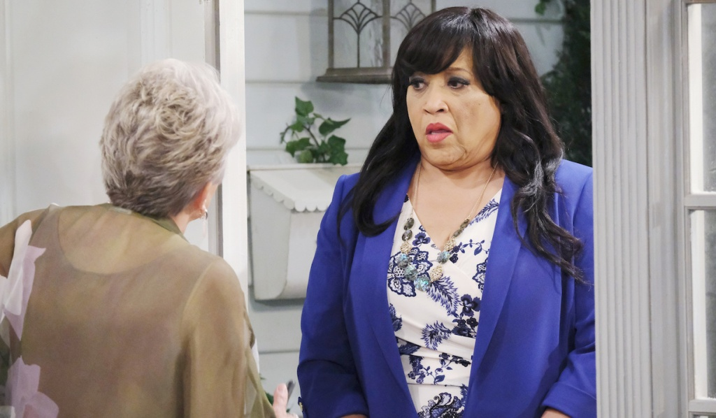 Julie opens the door to Paulina on Days of Our Lives