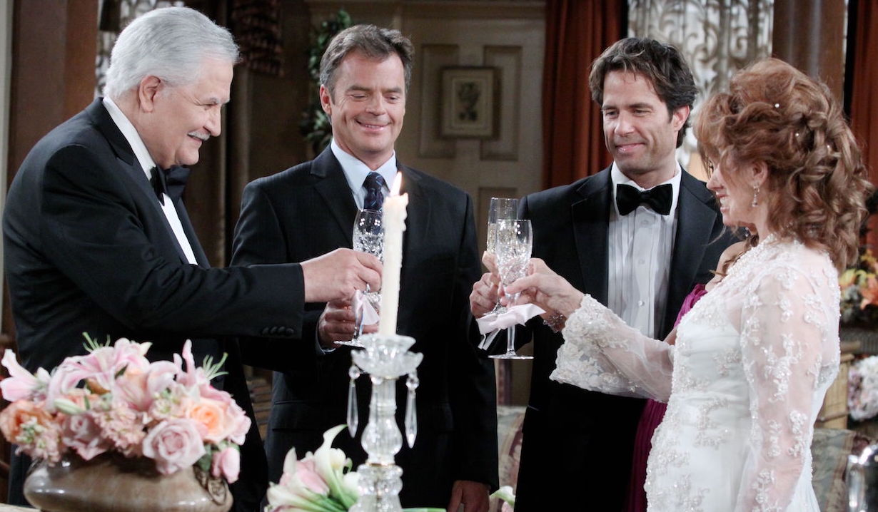 Victor, Maggie, Justin, Daniel and Melanie toast on Days of Our Lives