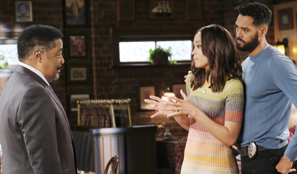 Eli backs up Lani as she makes a point to Abe at Brady's Pub on Days of Our Lives