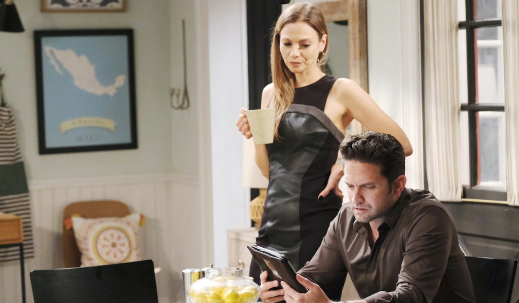 Ava reads over Jake's shoulder on Days of Our Lives