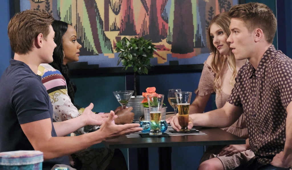 Allie looks annoyed as Johnny explains over drinks with Chanel and Tripp on Days of Our Lives