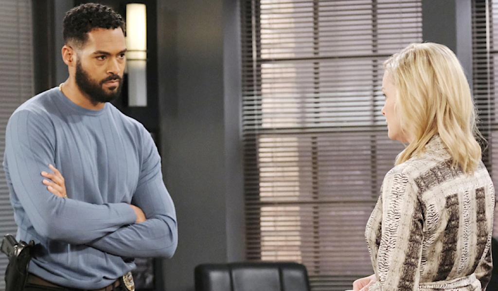 Eli and Belle confer at the Salem PD on Days of Our Lives