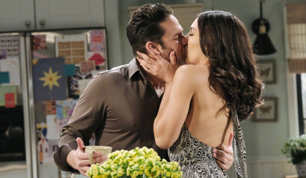 Gabi grabs Jake for a kiss on Days of Our Lives