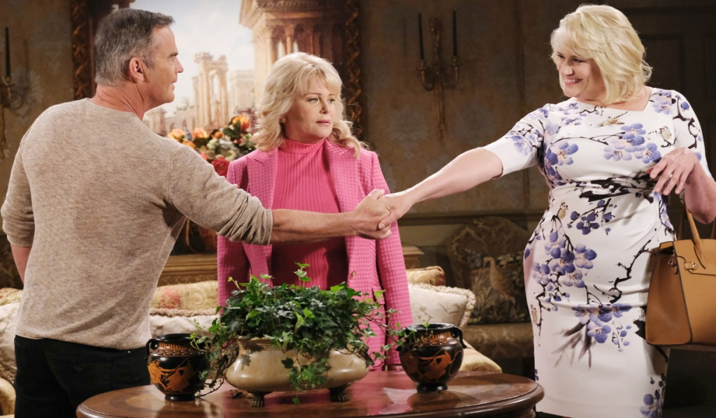 Justin shakes Calista's hand in front of Bonnie on Days of Our Lives
