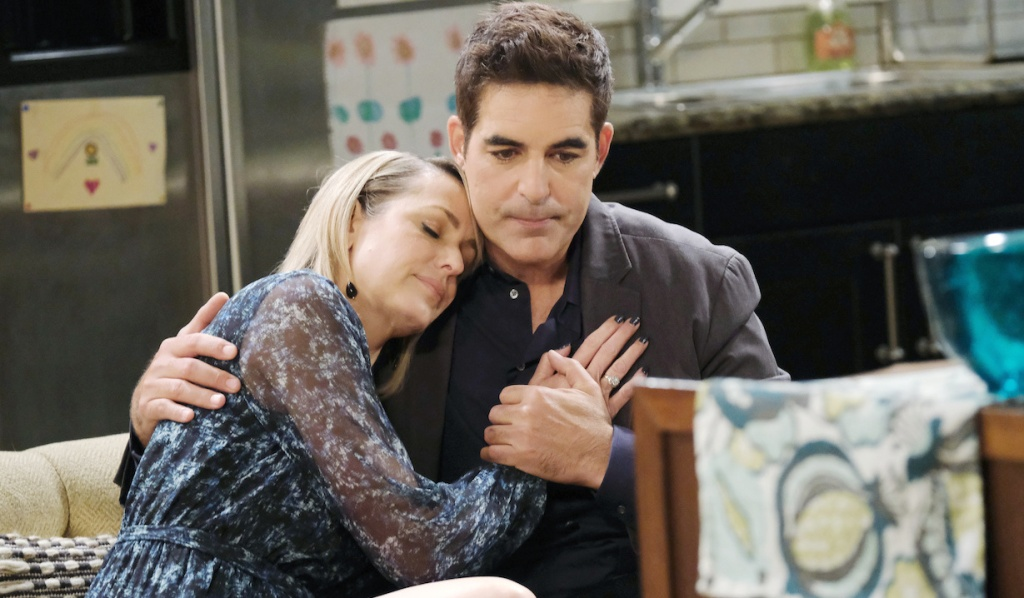 Nicole leans on Rafe's shoulder on Days of Our Lives