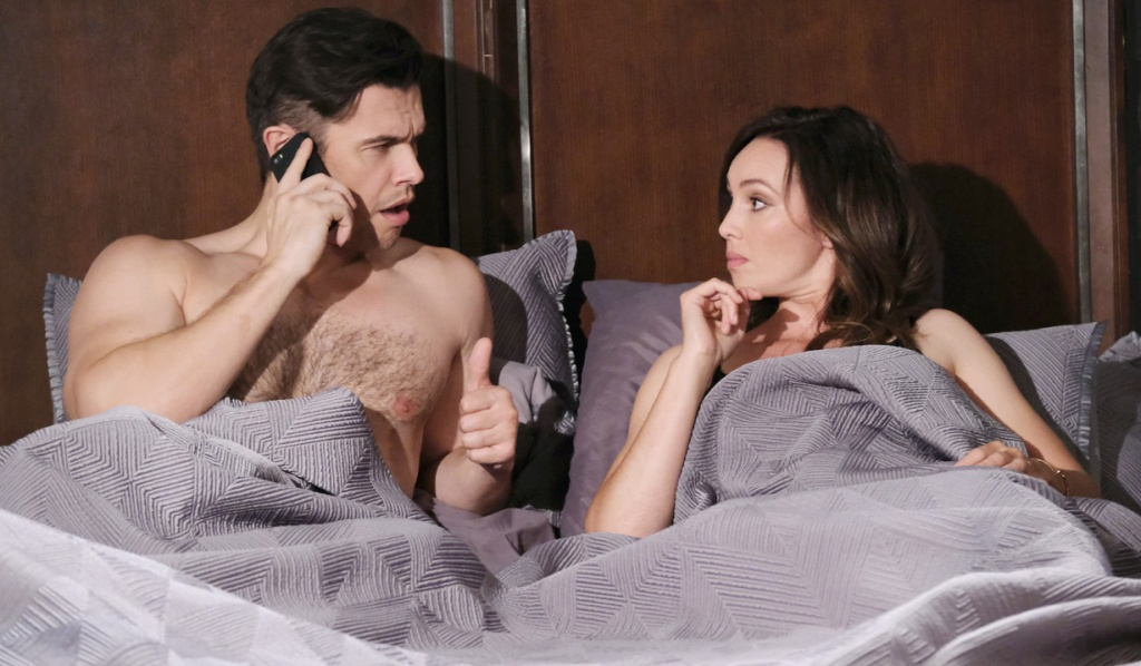 On the phone, Xander gives Gwen a thumbs up in bed on Days of Our Lives